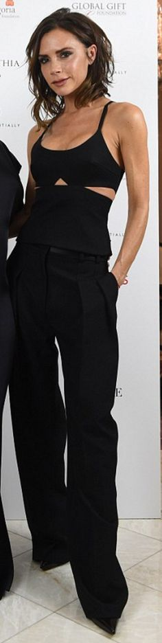Who made  Victoria Beckham's black pants and cut out top?