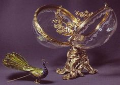 The most impressive egg after Karl Faberge, including the peacock (enamel) and crystal sphere-nest on the golden tree. The peacock can sit on the tree.  The egg was created in 1908 for Maria Feodorovna, The Empress of Russia. Today one can see the egg in Switzerland, Sandoza Fund.