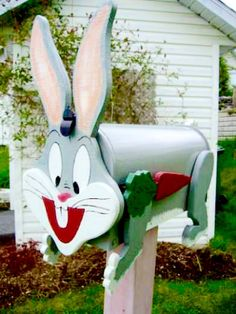 Bugs Bunny - Handcrafted and hand painted animal mailboxes by artist Michel Devost in Quebec. If you would like to order a special mailbox, contact Michel at http://pages.globetrotter.net/miche/mailboxes.html