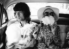 Mick Jagger and Marianne Faithfull eating candy floss, photographed by Adger Cowans in 1968.