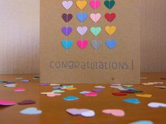 Engagement card by paper blossom Something like this could be used for any occasion and any shape/colour theme/word.