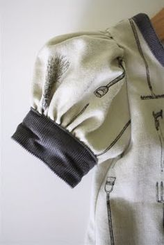 TUTORIAL: Puffed Sleeves--ignoring the tutorial; just to remind me of the idea of making puffed sleeves of cute sweat shirts and using the wrist band as the elastic cuff,