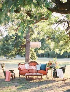 Unique vintage outdoor wedding reception lounge idea - antique furniture with coffee table in center with candlesticks + chandelier hanging from tree {Ben Q. Photography} #antiquefurniture #weddingcandlestick