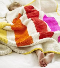 bed sleeping child, color stripes