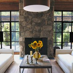 Steel Frame Windows + floor to ceiling stone fireplace http://thayermanor.wordpress.com/