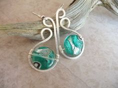 Hey, I found this really awesome Etsy listing at https://www.etsy.com/listing/189446306/wire-wrapped-earrings-silver-and