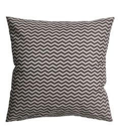 Cushion cover in woven fabric with a printed pattern. Concealed zip. Size 20 x 20 in.