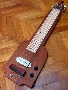 like the wood bridge cover Cigar Box Guitar, Music Stuff, Music Music, Electric Guitar Kits, Pedal Steel Guitar, Slide Guitar, Guitar Building, Musical Instruments, Musicals