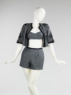 "Carolyn Schnurer (American, 1908–1998) | Beachwear, Playsuit, 1952 | Cotton, silk - textile by Irwin Textile Mills |  ""Gold Coast Memos"" collection Embroidery & braid trim inspired by Islamic Hausa boy's jacket in Ghana"