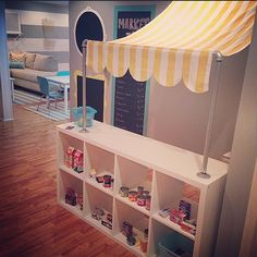 Pear Design Studio... Kid's marketplace with IKEA expedit
