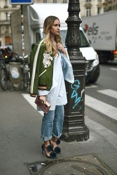 Le Fashion Blog Blogger Style Ombre Hair Embroidered Green Bomber Jacket White Flare Sleeved Tunic Clutch Cuffed Raw Hem Jeans Fur Pom Pom Pumps Via Nina Suess