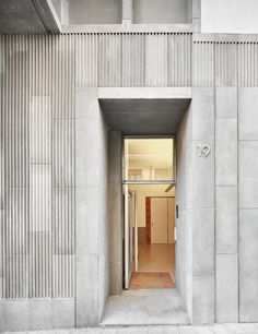 Raimon Farré Moretó, José Hevia · 8 Apartments in Gràcia Concrete Facade, Stone Facade, Concrete Wood, Entrance Design, Facade Design, Minimalist Architecture, Facade Architecture, Feature Wall Design, Cladding Materials