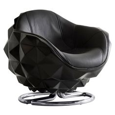 Andrew+Martin+Atom+Chair+-+Futuristic+leather+swivel+chair+with+polished+stainless+steel+base. Choose+the+daring+designer+decadence+of+the+Andrew+Martin+Atom+Chair. A+futuristic+take+on+deep+sea+naval+marine+mines,+this+iconic+design+piece+features+a+cladded+exterior+of+geometric+pyramids. Sculpted+from+black+lacquer,+the+exterior+then+nestles+a+comfortable+swivel+chair+upholstered+in+luxurious+black+leather. The+design+is+complete+with+a+rounded+polished+steel+base+offering+a+fine+fusio...