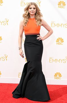 The Game of Thrones and The Hunger Games: Mockingjay pt. 1 star arrives at the 66th Primetime Emmy Awards.