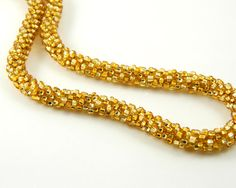 Hey, I found this really awesome Etsy listing at https://www.etsy.com/listing/188476225/shiny-gold-kumihimo-necklace