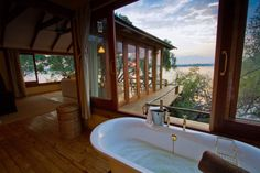 Explore Victoria Falls & Livingstone while you stay at the Tongabezi Lodge. The Tongabezi Lodge offers authentic accommodation, great food & much more. Livingstone, River Cottage, Most Romantic Places, Secluded Beach, Victoria Falls, Dog Houses, Lodges, Wonders Of The World, Luxury