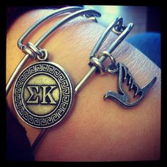 Alex and Ani Sigma Kappa and Dove. I have the SK one and I love it! Just need the dove now