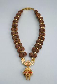 Double Rudraksha Seeds with gold spacers & focals.