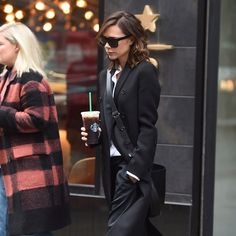 Victoria Beckham in Victoria Beckham, Adidas, and Starbucks