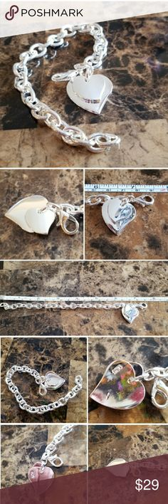 """Beautiful Sterling 2 Hearts Bracelet 7.5"""" 2 dangling hearts charm looks so beautiful hanging from this perfect bracelet. Set in 925 stamped Solid Sterling Silver. Please see all pictures for more detail and. Brand New  Never Worn. WHOLESALE Prices Always!! Jewelry Bracelets"""