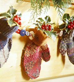 Mitten and Button Garland ----------------  Put a button collection and mismatched mittens to use for this homespun holiday garland. Thread buttons and mittens onto wire and tuck a holly sprig inside each mitten, securing with a dab of hot glue.