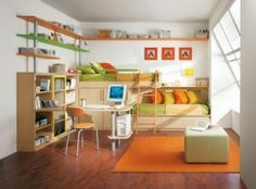 What a fun room for a child! I love the colors and the great beds!