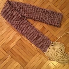 Handmade scarf Beautiful lilac hand knit scarf with ivory tassels. 72 inches long, 3.5 inches wide. Worn once. Accessories Scarves & Wraps