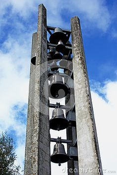 Photo about A unique freestanding bell tower of a small church in Switzerland featuring many bells of various sizes. Image of bells, bell, switzerland - 80804649 Switzerland, Tower, Stock Photos, Unique, Image, Computer Case, Towers, Building