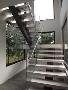 modern stairs and railings in Winnipeg and surrounding area. Open staircase with glass railing, metal, stainless steel or wood Staircase Design Modern, Stair Railing Design, Home Stairs Design, Staircase Railings, Glass Railing, Modern Stairs, Interior Stairs, Modern House Design, Staircase Glass Design