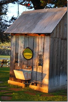 Love this little shed with the old type sink w/mirror. Mine looks like an outhouse that I use for my yard tools.