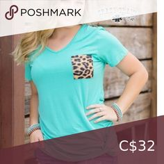 NWT Crazy Train Tee with Leopard NWT Crazy Train Short sleeved tee with leopard pocket and knot hem. Super soft, flowing and comfy Only one available, size small. Top Knot, Cute Tops, Short Sleeve Tee, Knots, Dress Up, Super Cute, Comfy, Train, Turquoise