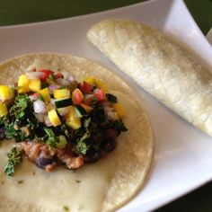 Vegetarian Soft Shell Tacos: guts include pepper jack cheese, refried beans, black beans, garlic sautéed kale cilantro & tomatoes, plus a mango cucumber salsa w/ red onion, poblano pepper, yellow pepper & fresh lemon juice