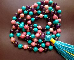 On SALE Until December 15th!     Beautiful unique One of a kind pretty candy colored mala with 8mm size beads of stabilized turquoise, pink rhodochrosite And dark purple amethyst. With a 10 mm amethyst guru bead.  Turquoise- The natural energy of these stones will help you to communicate with truth. They are a strong stone of spiritual attunement and are very effective to aid communication. They have a strong effect within the throat chakra, and they may aid you to manifest clairaudient and…