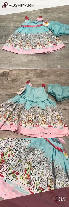 NWT Girl's Jessica Ann dress NWT Light blue dress with city scape design on the bottom, pink belt ribbon and rosette. Comes with matching bloomers jessica ann Dresses