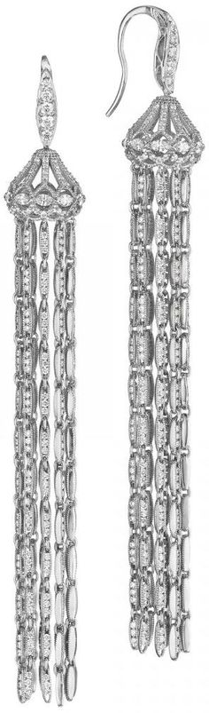 Tacori Vault Style-A one of a kind red carpet piece from the Tacori Vault. Keeping with the trendy tassle look, these earrings are sure to brighten up the red carpet. Beautiful strands of white gold embedded with brilliant diamonds cascade down from white gold and diamond embdedded chandelier tops.