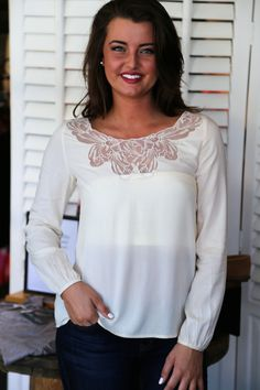 "White with lace trim blouse from ""the Rage"" boutique"