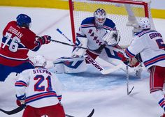 New York Rangers goalie Henrik Lundqvist (30) blocks the shot of Montreal Canadiens defenseman P.K. Subban (76) in Game One of the Eastern Conference Finals of the 2014 NHL Stanley Cup Playoffs at the Bell Centre on May 17, 2014 in Montreal, Canada. (Andre