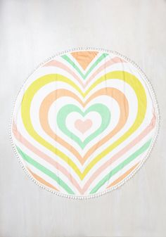 Your quest for a flirty-yet-functional beach accessory ends with this white towel by Lolli Swim! An adorable, round piece for after swimming and all-day sunbathing, this terrycloth covering showcases a layered, pastel heart print and a pretty pom-pom trim that goes 'a-love' and beyond your expectations.