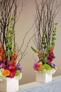 How gorgeous are these tropical wedding reception arrangements. They would look perfect as tall table centrepieces or as wedding reception entrance arrangements. | Check in table florals.