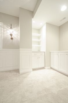 Wainscoting and Repose Gray  Paint in basement with built in