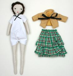 "doll is made from 100% cotton,  wool, wool felt, and polyester filling  she measures about 10,5""high (26 cm)    Please note doll is not suitable for children  under the age of 3 due to small parts. $100 (65pnds)"