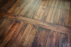 """From trash to treasure, the mixed woods in this attractive floor came from weathered wooden shipping pallets. Laid in a pattern inspired by a Spanish design, the wood is abraded to let the natural color come through then finished to withstand lots of wear and tear from pets, guests and everyday use.  This floor was named the """"Wood Floor of the Year - Best Reclaimed"""" by the National Wood Flooring Association.  http://www.schenckandcompany.com/workAPPEALING_PALLETS.html"""