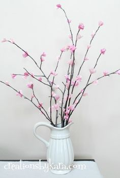 "DIY Cherry Blossoms; Just thought ""if you're artistic enough you can paint this on your wall and have half of a vase on the wall. Not sure how you'd get the vase in half perfectly though... Sculpt one out of clay? Hm!"