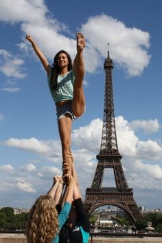 plus 0/2 New challenge: Cheer stunts across the world.  What I loved about cheering: Stunting in random places (Eiffel Tower)