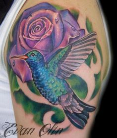 Nice hummingbird & rose tattoo.