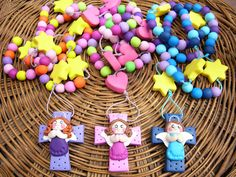Colorful rosary for children. Beads and cross manually made from polymer clay.