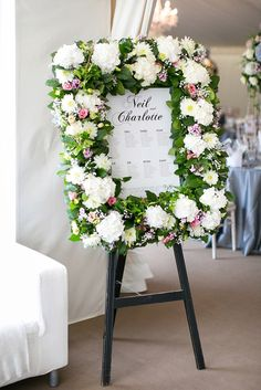 Wedding table plan with flower garland frame | Photography by http://www.annelimarinovich.com/