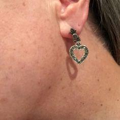 Marcasite earrings Silver Marcasite heart earrings. One earring is missing two stones but is not very noticeable. Freshly polished. Jewelry Earrings