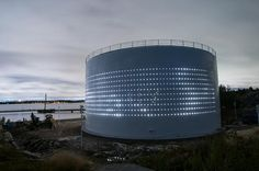 An old silo in Helsinki, Finland converted into light art piece/public space by Lighting Design Collective (LDC)