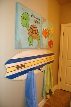 """Surfboard Towel Rack - how fun! It's making me think what other """"normal"""" object I could use as a towel rack. Beach Bathrooms, Bathroom Kids, Kids Bath, Bathroom Storage, Shark Bathroom, Childrens Bathroom, Shark Room, Surfboard Decor, Surfboard Rack"""